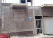Edificio de vivienda con garaje y azotea.